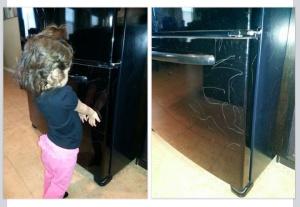My daughter showing me her fridge artwork <3